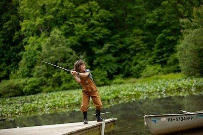 Child casting from dock