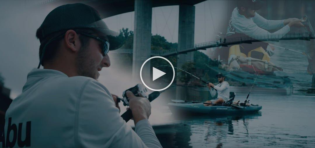 Angler in kayak reeling in a fish