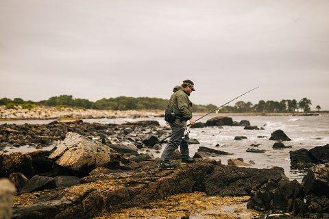 Angler scouting on beach
