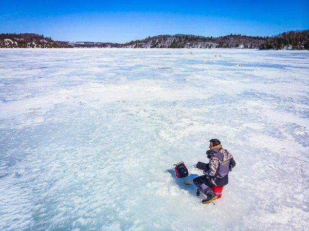 Ice fisherman on ice