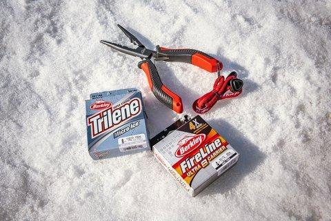 Two fishing line packages and pliers