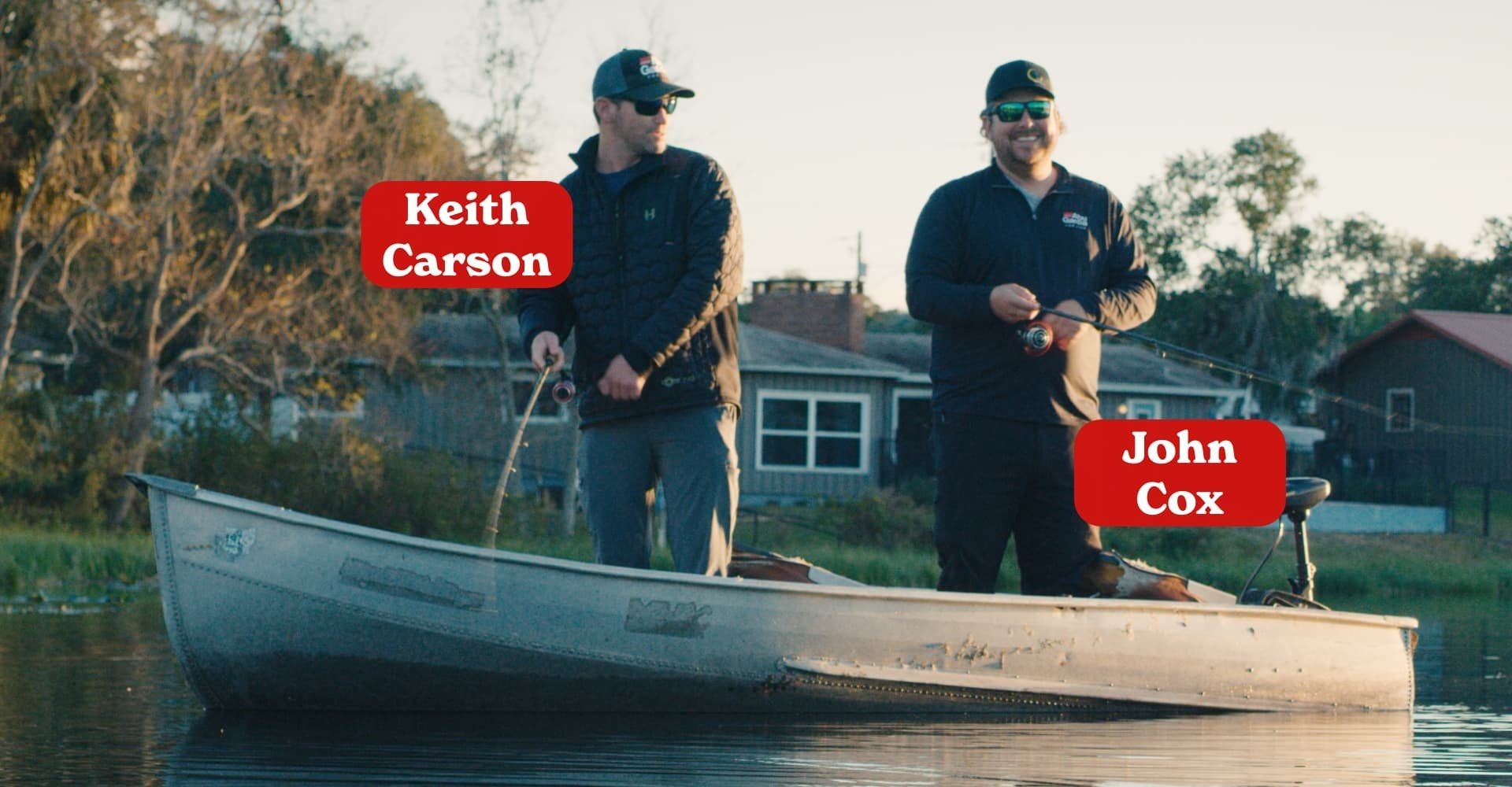 Cox and Carson standing on boat fishing