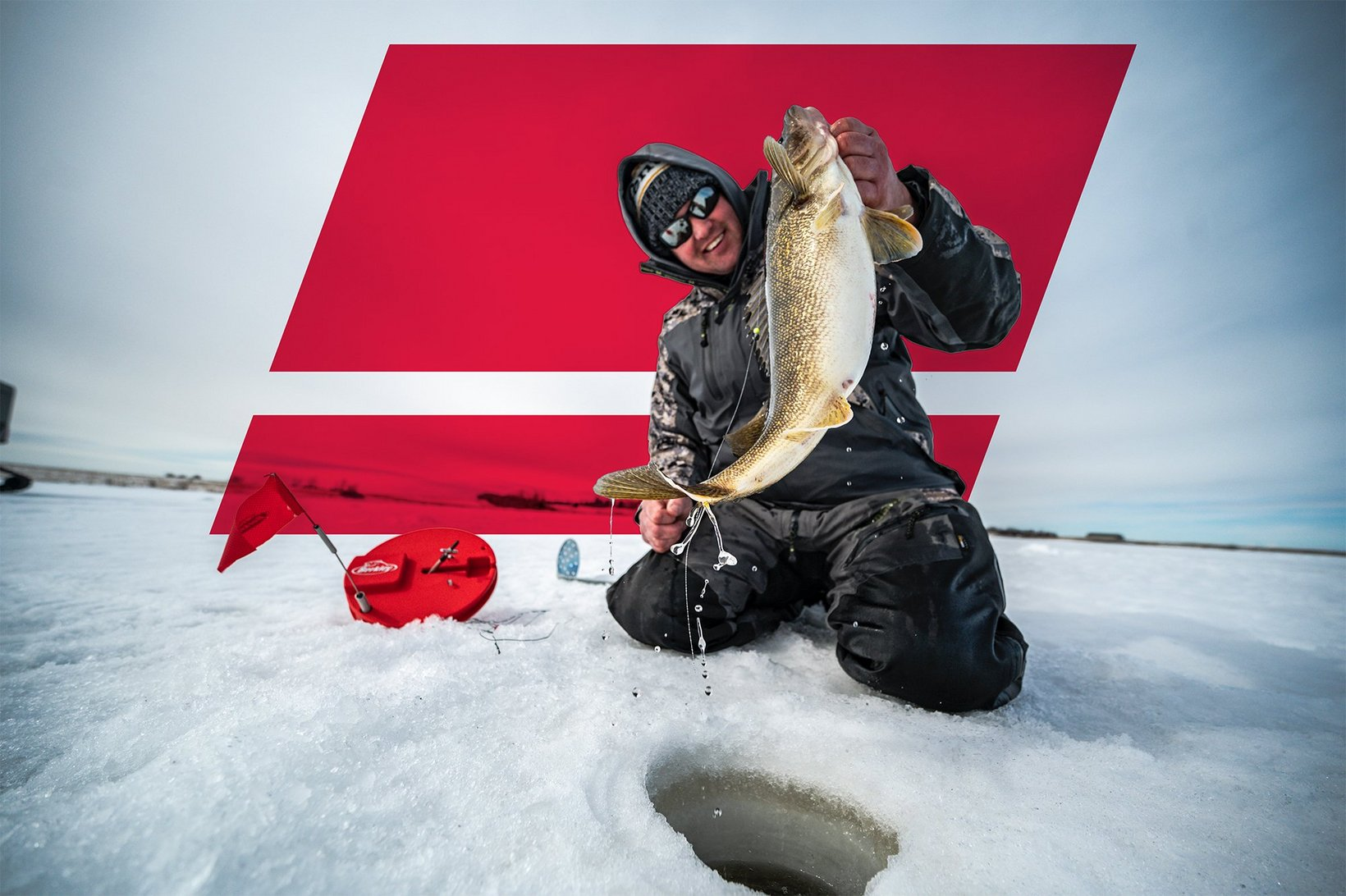 Angler holding fish on ice in front of superimposed Abu Garcia logo