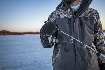 Close up of angler holding Max Ice reel
