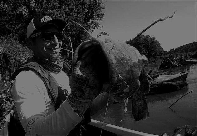 Angler holding large catfish