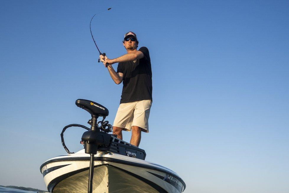 Angler casting off of boat