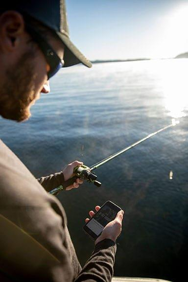 Angler looking down at phone