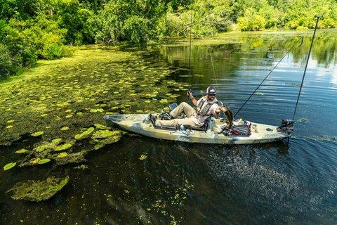 Angler in kayak holding fish