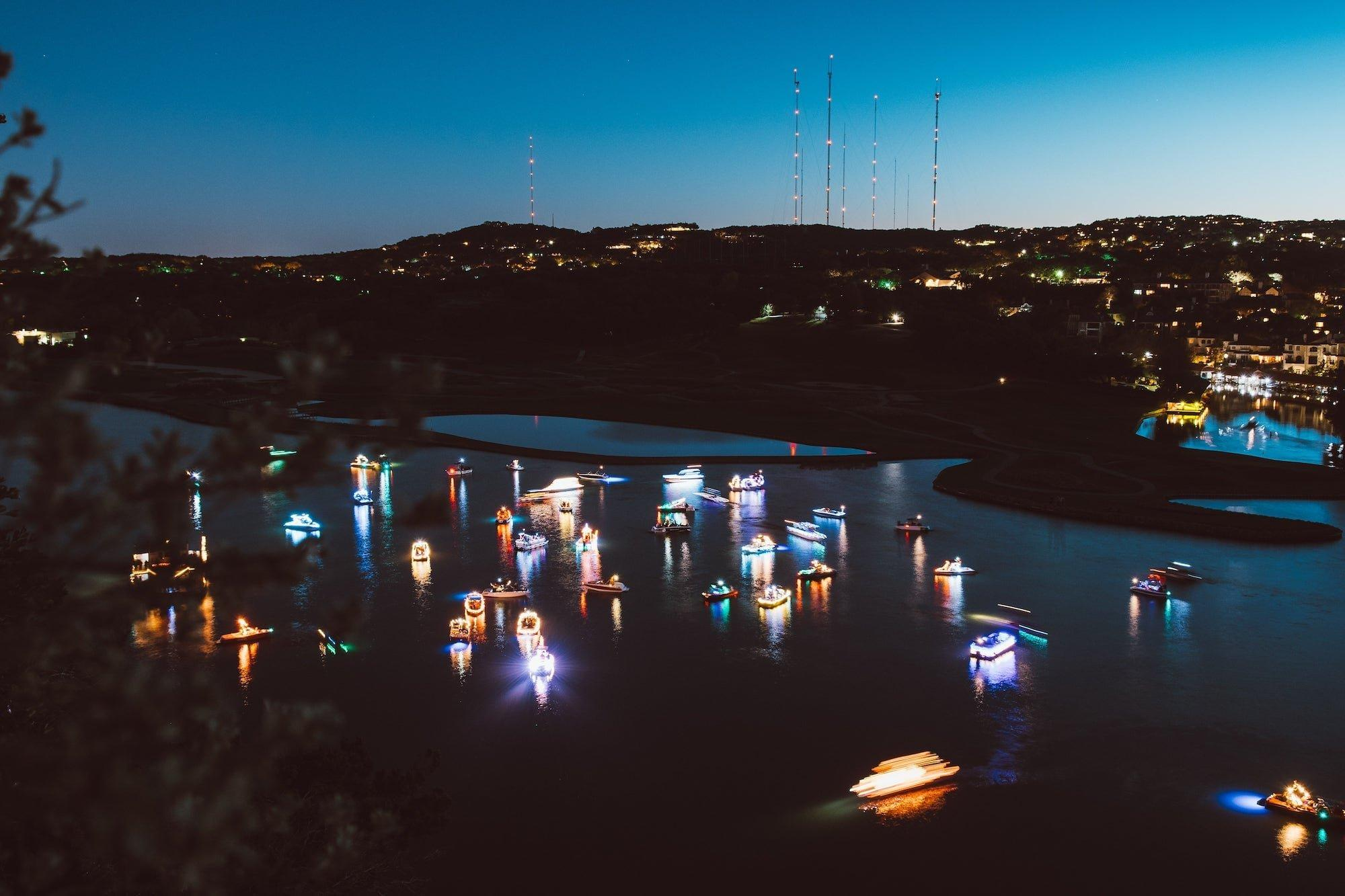 Boats in water decorated for holidays